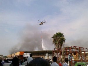 Helicopter of the Rwanda Defense Force putting of fire in the Bujumbura market